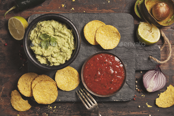 Mexican nachos chips with homemade fresh guacamole sauce and sal - Stock Photo - Images