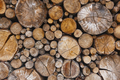 Stacked tree trunks detail. Finland lumber industry. Nature background. Horizontal
