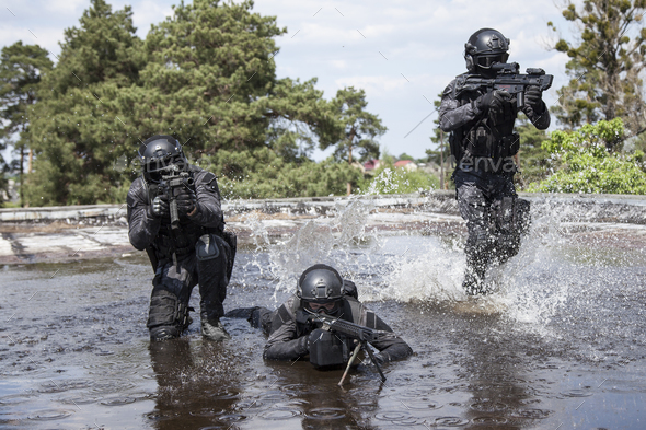 Spec ops police officers SWAT in the water - Stock Photo - Images