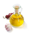 bottle of olive oil isolated at white
