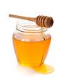 glass jar full of honey and dipper - PhotoDune Item for Sale