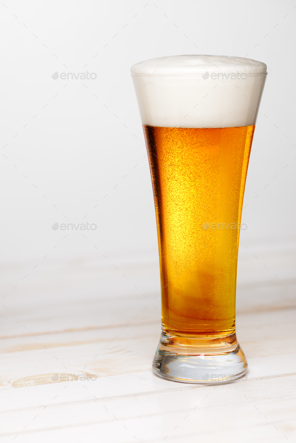 Glass of beer on white - Stock Photo - Images