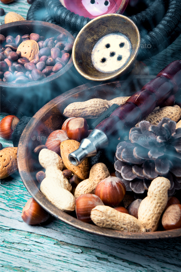 Hookah with nut tobacco taste - Stock Photo - Images