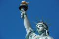 Statue of Liberty in New York in a sunny day, blue sky - PhotoDune Item for Sale
