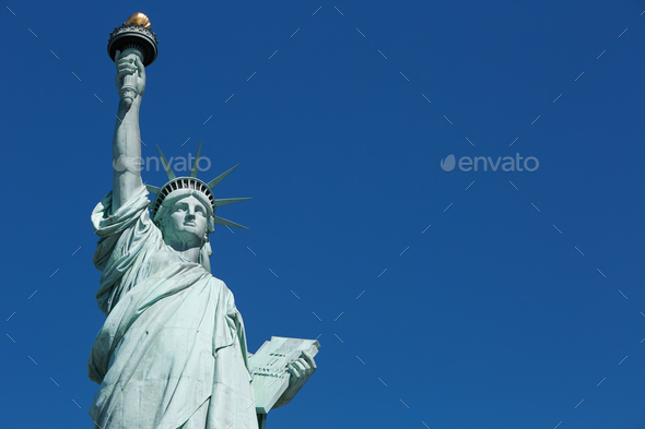 Statue of Liberty in a sunny day, blank blue sky space - Stock Photo - Images
