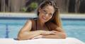 Charming model posing in pool - PhotoDune Item for Sale