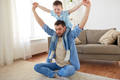 father with son playing and having fun at home