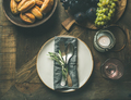 Fall table setting with cutlery and decoration, copy space