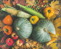 Fall vegetables assortment over wooden table background
