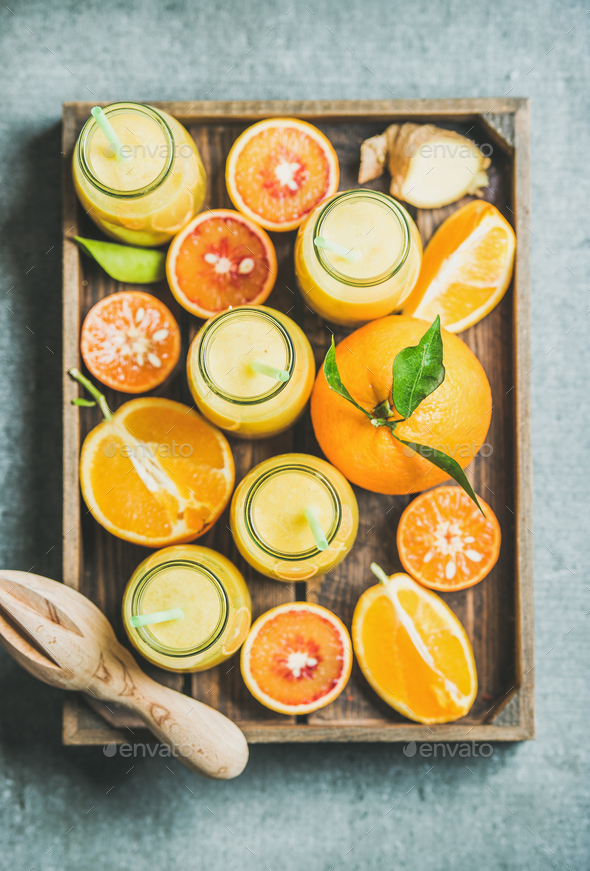 Healthy yellow smoothie in bottles with fresh fruits, top view - Stock Photo - Images