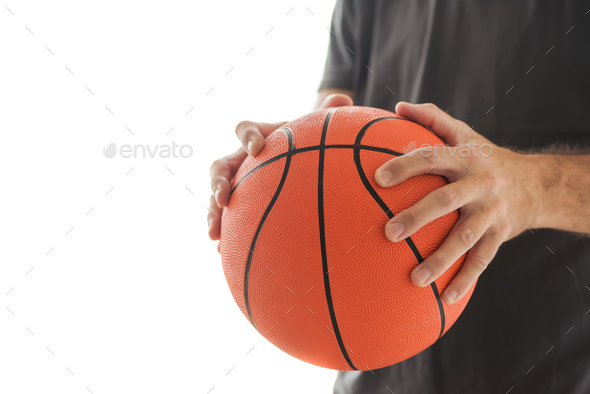 man holding basketball stock photo by stevanovicigor photodune