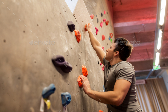 young man exercising at indoor climbing gym - Stock Photo - Images