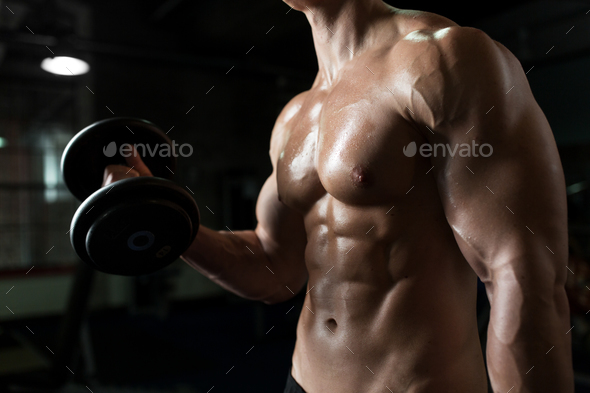 close up of man with dumbbells exercising in gym - Stock Photo - Images