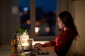 student or woman typing on laptop at night home