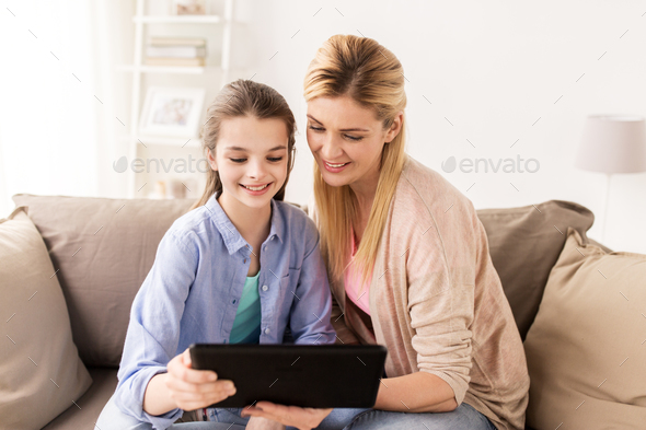 happy family with tablet pc at home - Stock Photo - Images