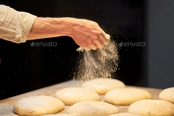 chef or baker making bread dough at bakery - Stock Photo - Images