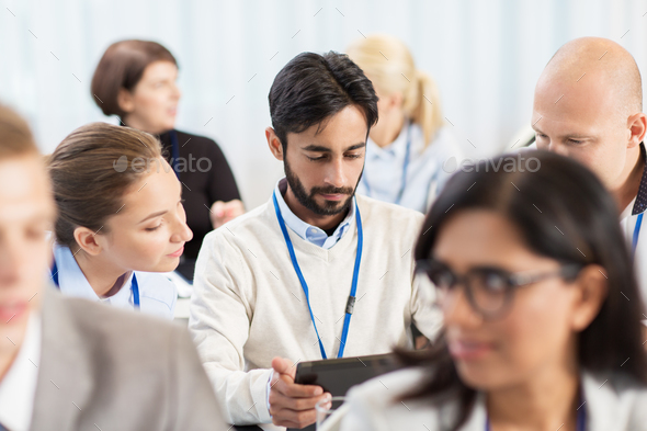team with tablet pc at business conference - Stock Photo - Images