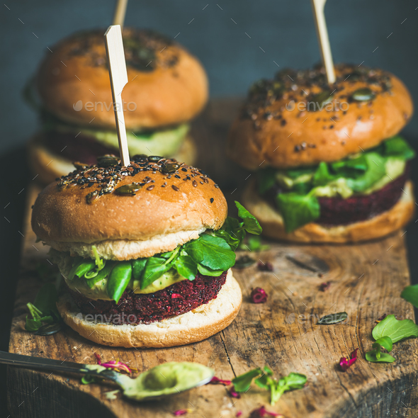 Healthy vegan burger with beetroot-quinoa patty and avocado sauce - Stock Photo - Images