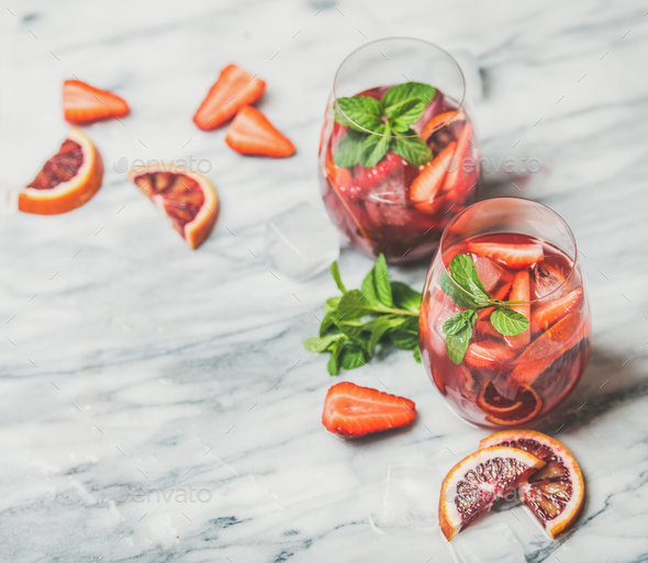 Fruit refreshing Sangria cocktails with ice and fresh mint - Stock Photo - Images