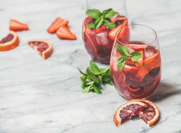 Fruit refreshing Sangria cocktails with ice cubes and fresh mint - Stock Photo - Images