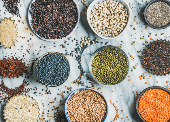 Various raw uncooked grains, beans, cereals, marble background, top view - Stock Photo - Images
