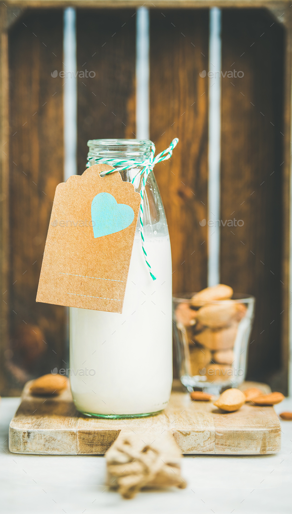 Fresh vegetarian dairy-free almond milk served with nuts - Stock Photo - Images