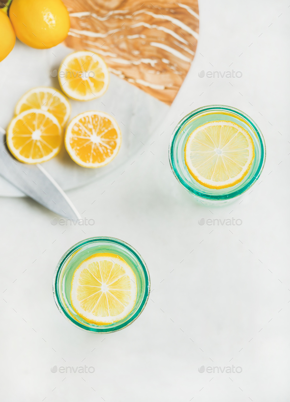 Detox lemon water in glasses, top view, copy space - Stock Photo - Images