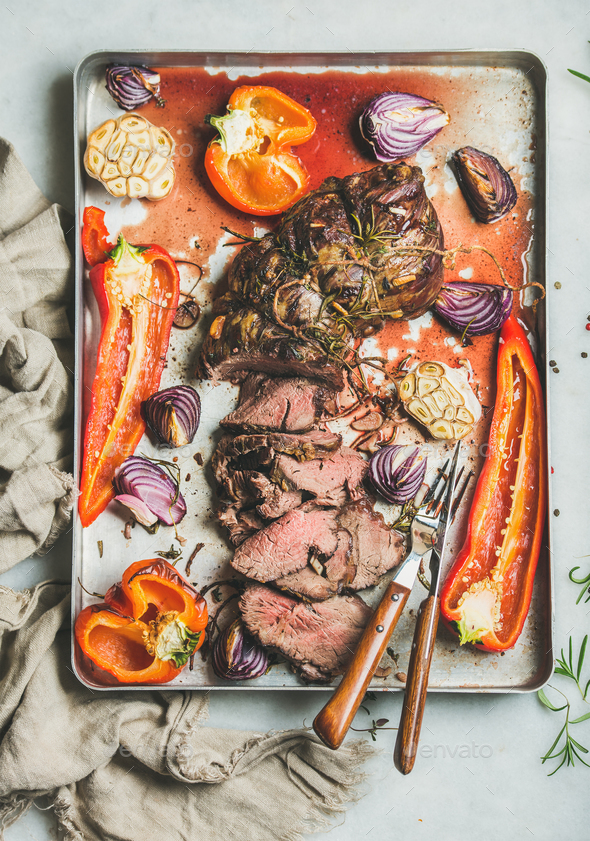 Cooked Roastbeef meat with grilled vegetables and herbs - Stock Photo - Images