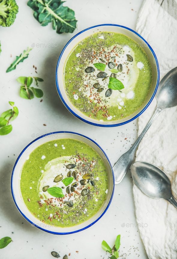 Spring broccoli cream soup with fresh mint and coconut cream - Stock Photo - Images