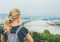 Young woman traveler looking at Danube river, Budapest, Hungary