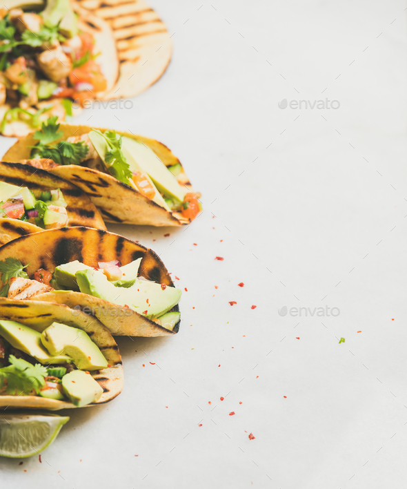 Healthy corn tortillas with grilled chicken, avocado, lime, copy space - Stock Photo - Images