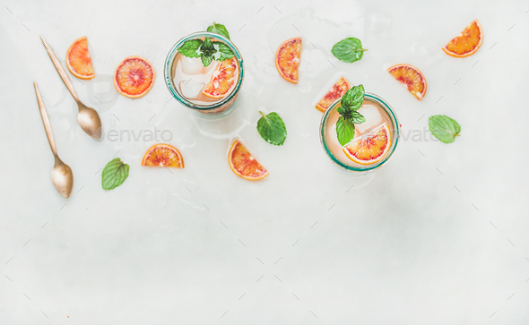 Homemade blood orange lemonade in glasses, copy space - Stock Photo - Images
