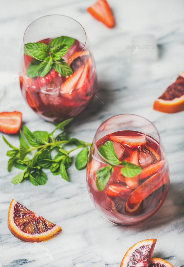 Fruit refreshing Sangria cocktails in glasses with ice and mint - Stock Photo - Images