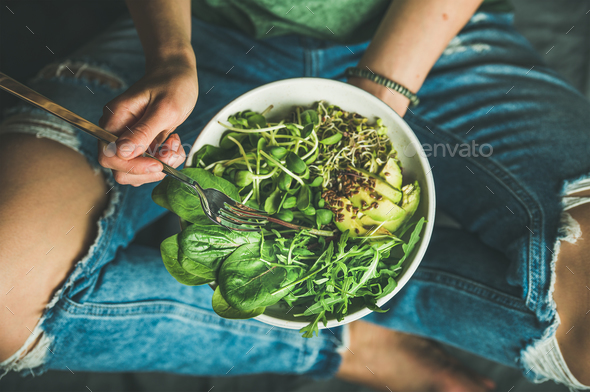 Vegetarian breakfast with spinach, arugula, avocado, seeds and sprouts - Stock Photo - Images