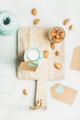 Fresh vegetarian dairy-free almond milk in bottle, top view
