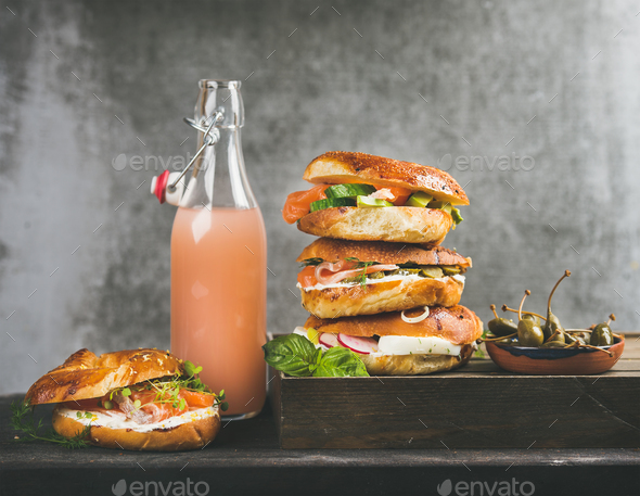 Bagels with salmon, eggs, vegetables, capers, cream-cheese and grapefruit lemonade - Stock Photo - Images