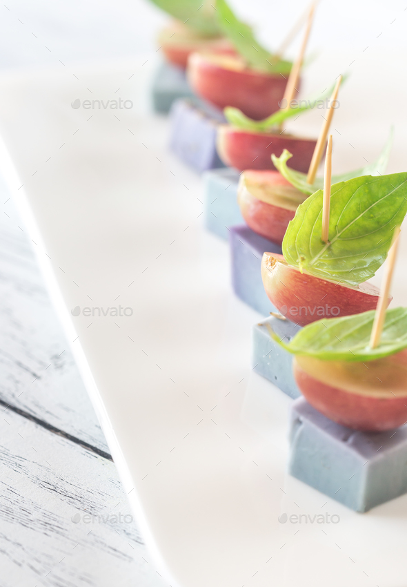 Canape with lavender cheese, grapes and basil - Stock Photo - Images