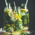 Citrus fruit and herbs infused sassi natural water, square crop