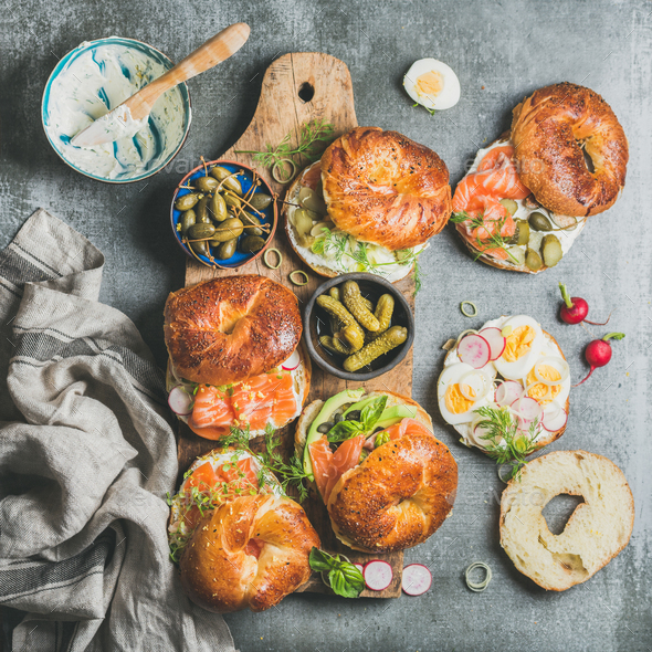 Variety of bagels with vegetables, salmon and cream cheese - Stock Photo - Images