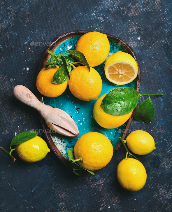 Freshly picked lemons with leaves in blue ceramic plate - Stock Photo - Images