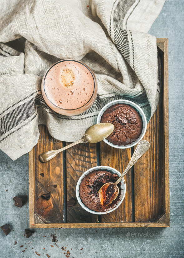 Chocolate souffle in individual baking cups and mocha coffee - Stock Photo - Images