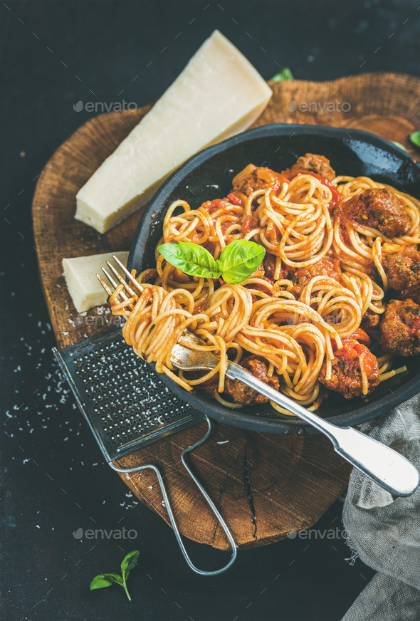 Italian dinner with meatballas, basil and parmesan cheese pasta - Stock Photo - Images