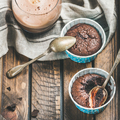 Close-up of Chocolate souffle in baking cups and mocha coffee - PhotoDune Item for Sale