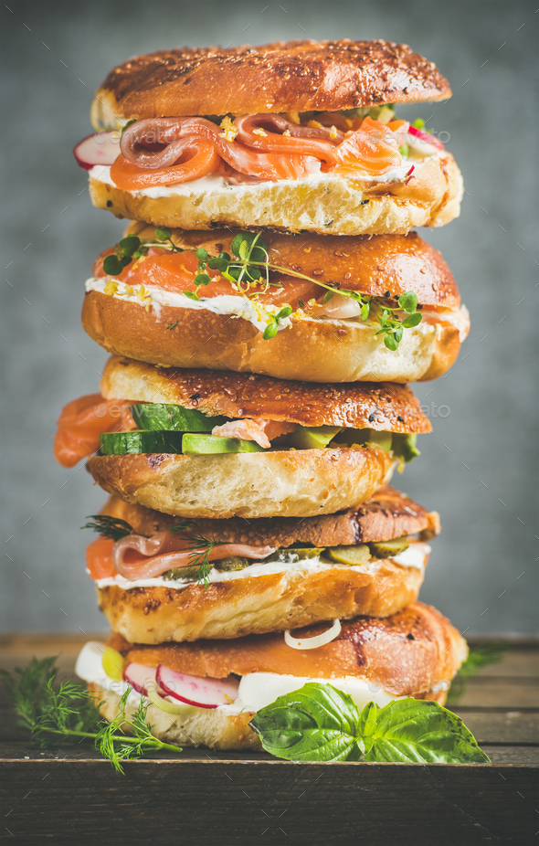 Heap of Bagels with salmon, eggs, vegetables, capers, cream-cheese, herbs - Stock Photo - Images