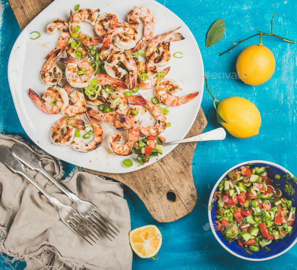 Grilled tiger prawns in white plate with lemon, salsa sauce - Stock Photo - Images