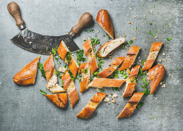 Slices of turkish pizza pide and herb chopper - Stock Photo - Images