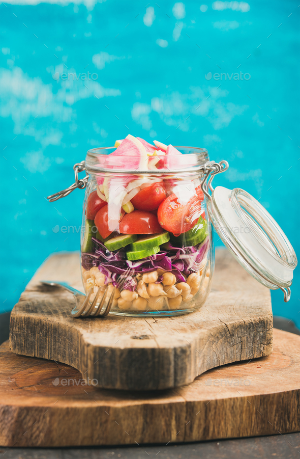 Vegetable and chickpea sprout vegan salad in jar, copy cpace - Stock Photo - Images