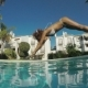 Woman Jumping To Pool
