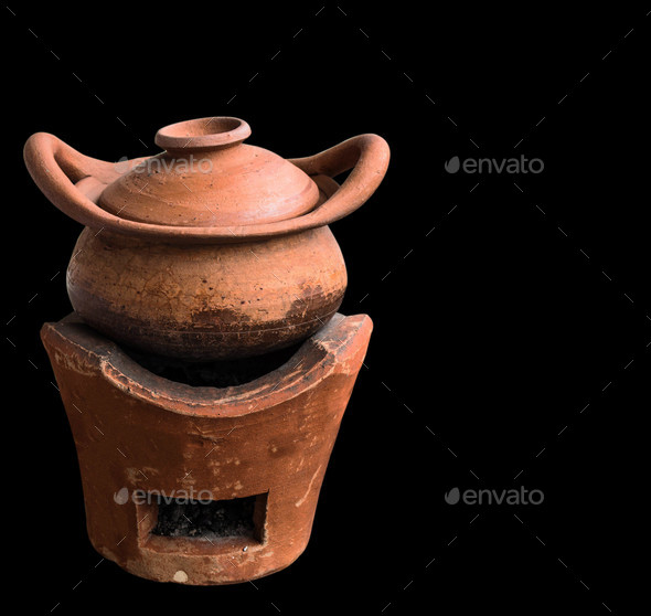 clay pot on black background - Stock Photo - Images