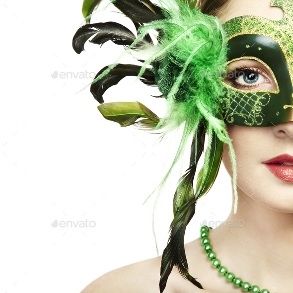 The beautiful young woman in a green mysterious venetian mask - Stock Photo - Images